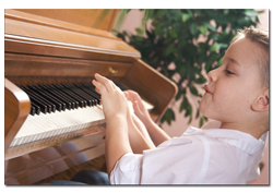 Child learning to play the piano